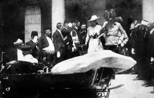 Heading for their car at the Sarajevo Town Hall, moments before the assassination, from the Europeana 1914-1918 collection, via Wikipedia.